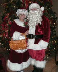velvet mrs santa claus suit with santa standing