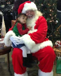 santa claus picture 2016 sitting with child